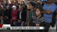 Visite guidée du parlement pour des réfugiés syriens