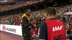 Usain Bolt retrouve le caméraman qui l'avait fait tombé